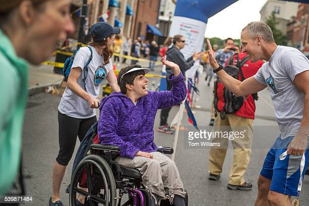Rep Sean Patrick Maloney DNY greets a participant after the 'Think Differently Dash' that benefits people with disabilities in Poughkeepsie NY June...