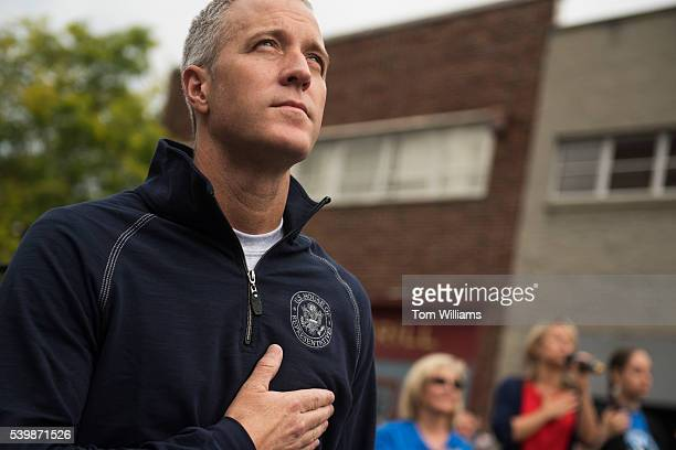 Rep Sean Patrick Maloney DNY listens to the National Anthem before the 'Think Differently Dash' that benefits people with disabilities in...