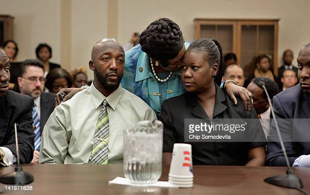 Rep Sheila JacksonLee embraces Sybrina Fulton and Tracy Martin the parents of Trayvon Martin during a House Judiciary Committee briefing in the...