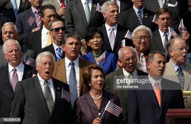 Rep Steny Hoyer House Minority Leader Nancy Pelosi and Speaker of the House John Boehner wave American flags along with other members of Congress as...