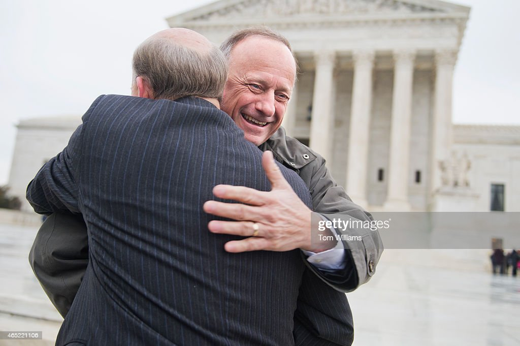 Rep. Steve King, R-Iowa, right, greets Rep. Louie Gohmert, R-Texas, during a rally outside of the Supreme Court during arguments in the King v. Burwell case which deals with tax credits in the Affordable Care Act, March 4, 2015.