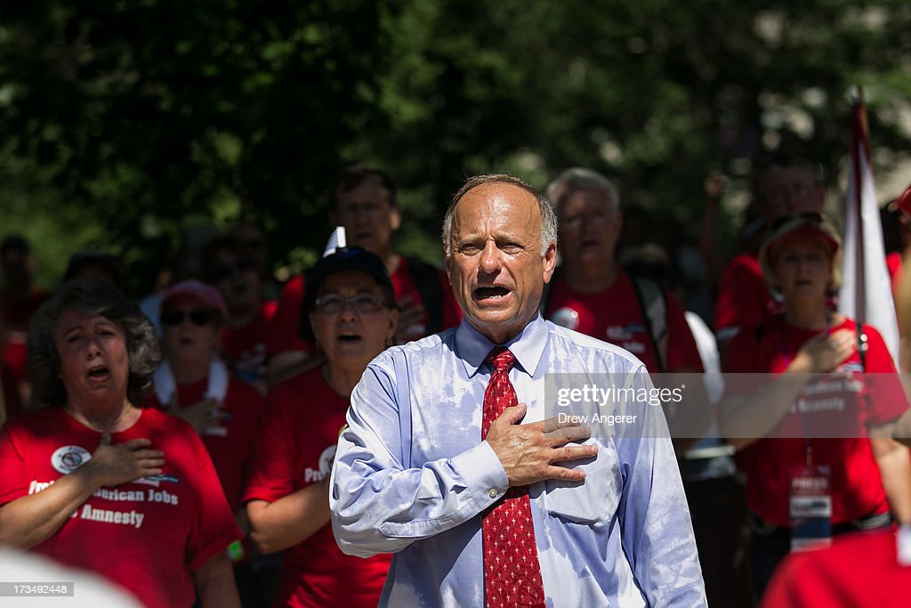 Rep. Steve King (R-IA) sings the National Anthem during the DC March for Jobs in Upper Senate Park near Capitol Hill, on July 15, 2013 in Washington, DC. Conservative activists and supporters rallied against the Senate's immigration legislation and the impact illegal immigration has on reduced wages and employment opportunities for some Americans.