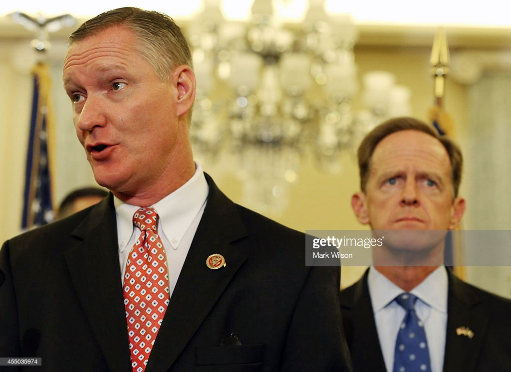 Rep. Steve Stivers (R-OH) (L) speaks about protecting students from sexual predators while Sen. <a gi-track='captionPersonalityLinkClicked' href=/galleries/search?phrase=Pat+Toomey&family=editorial&specificpeople=3370648 ng-click='$event.stopPropagation()'>Pat Toomey</a> (R-PA) (L) listens during a news conference on Capitol Hill, September 9, 2014 in Washington, DC. Sen Toomey and other members of Congress called on the U.S. Senate to pass H.R.2083, the Protecting Students from Sexual and Violent Predators Act of 2013.