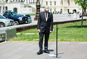 Rep Steve Womack RArk looks over the speaking order taped to the ground outside of the Capitol before the start of the news conference on Food and...