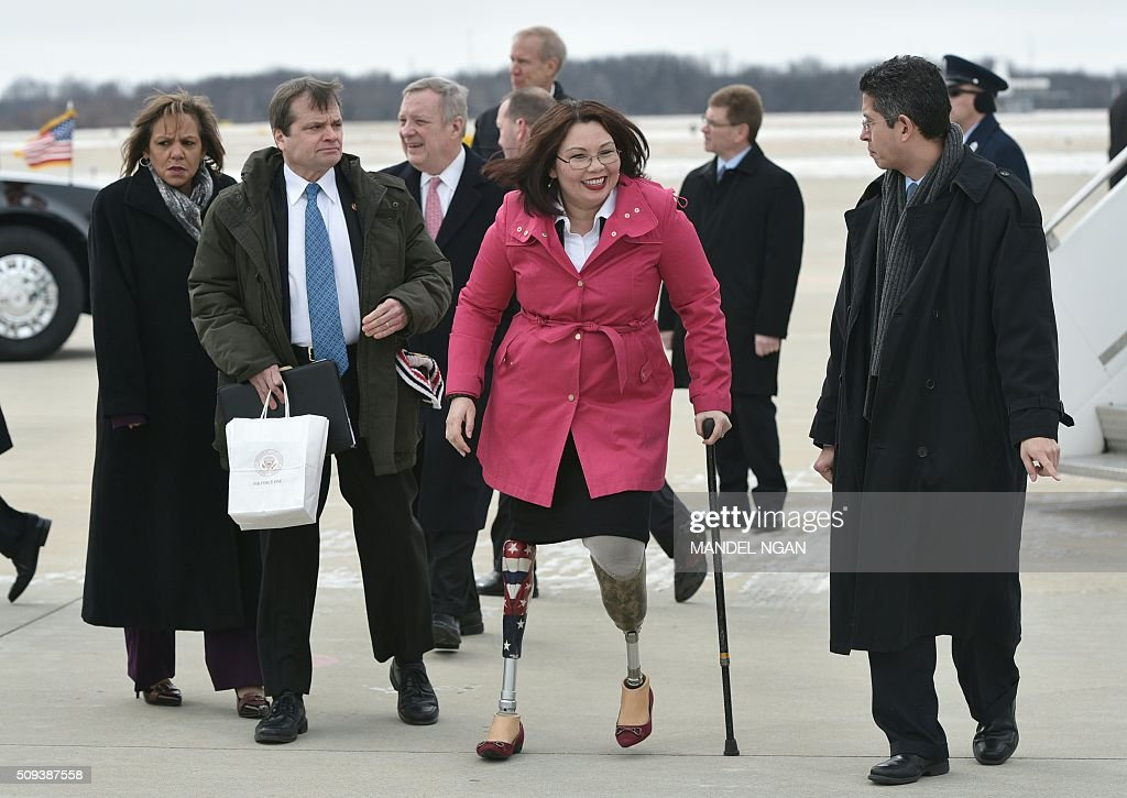 Rep. Tammy Duckworth C), D-IL, walks across the tarmac upon arrival at Abraham Lincoln Capital Airport in Springfield, Illinois on February 10, 2016, after arrival with US President Barack Obama on Air Force One. / AFP / Mandel Ngan
