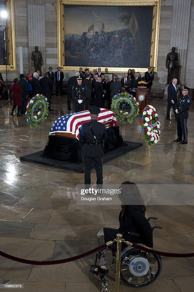 Rep. Tammy Duckworth, D-Ill., watches as the USCP stands guard over the flag draped casket of U.S. Senator Daniel Inouye (D-HI) in the Rotunda of the U.S. Capitol where he will lie in state December 20, 2012 on Capitol Hill in Washington, DC. The late Senator had died at the age of 88 on Monday at the Walter Reed National Military Medical Center in Bethesda, Maryland where he had been hospitalized since early December. A public funeral service will be held at the Washington National Cathedral on Friday for Senator Inouye, a World War II veteran and the second-longest serving senator in history. His remains will be returned and laid to rest in his home state.