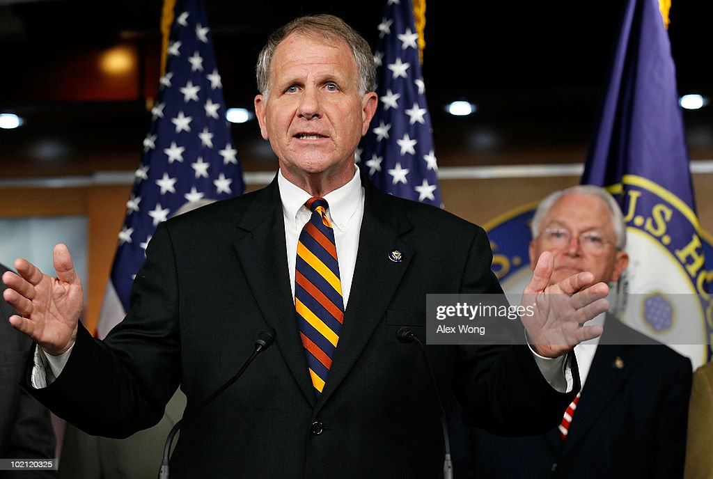 U.S. Rep. Ted Poe (R-TX) (L) speaks as Rep. Randy Neugebauer (R-TX) (R) listens during a news conference June 15, 2010 on Capitol Hill in Washington, DC. Members of the Gulf Coast Congressional delegation called on the Obama Administration for an end to the moratorium on new deepwater drilling.