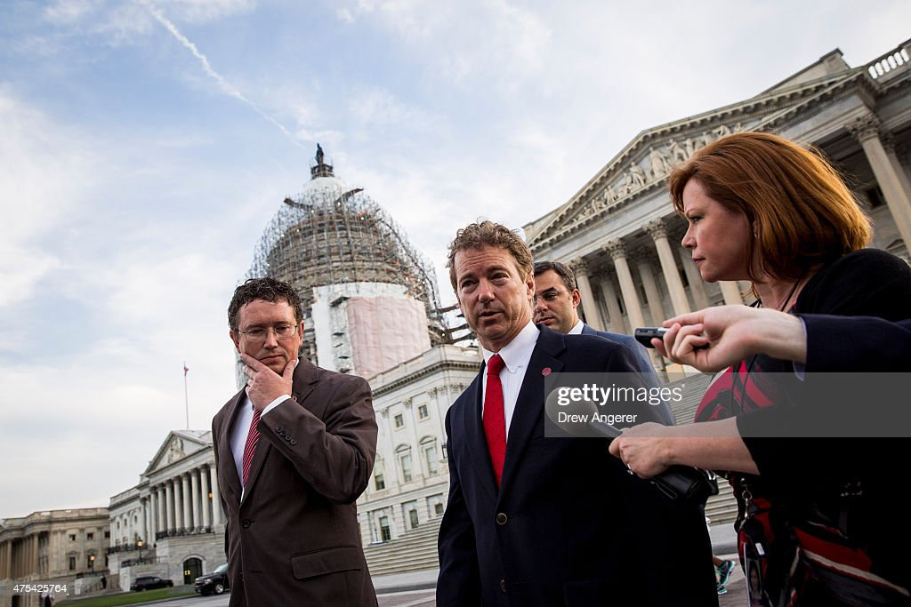 Rep. Thomas Massie (R-KY) listens as Sen. Rand Paul (R-KY) speaks to reporters after exiting the Senate chamber, on Capitol Hill, May 31, 2015 in Washington, DC. The National Security Agency's authority to collect bulk telephone data is set to expire June 1, unless the Senate can come to an agreement to extend the surveillance programs.
