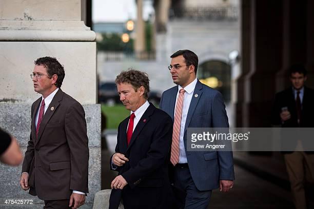 Rep Thomas Massie Sen Rand Paul and Rep Justin Amash exit the Senate chamber after Paul spoke about surveillance legislation on the Senate floor on...