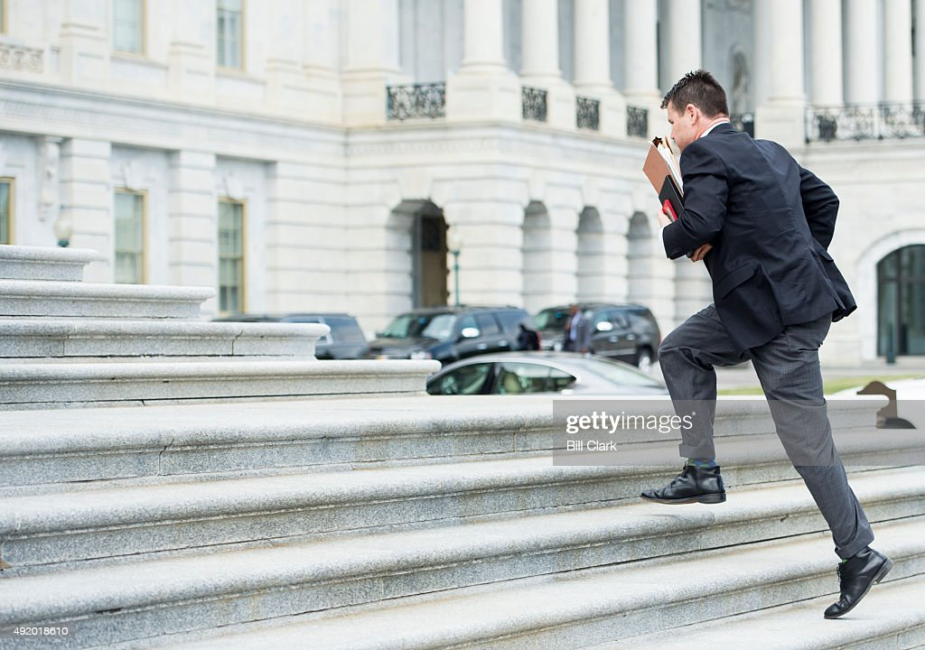 Rep Todd Young RInd runs up the House steps at the Capitol for the final votes before the Columbus Day recess on Friday Oct 9 2015