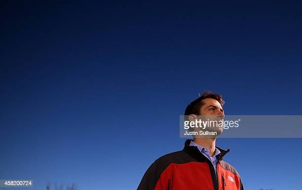 S Rep Tom Cotton and Republican candidate for US Senate in Arkansas looks on during a Fayetteville High School football game on October 31 2014 in...