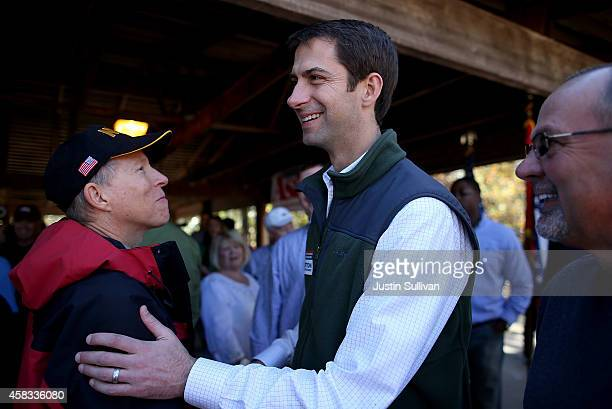 S Rep Tom Cotton and Republican candidate for US Senate in Arkansas greets supporters during a Republican party campaign rally on November 3 2014 in...
