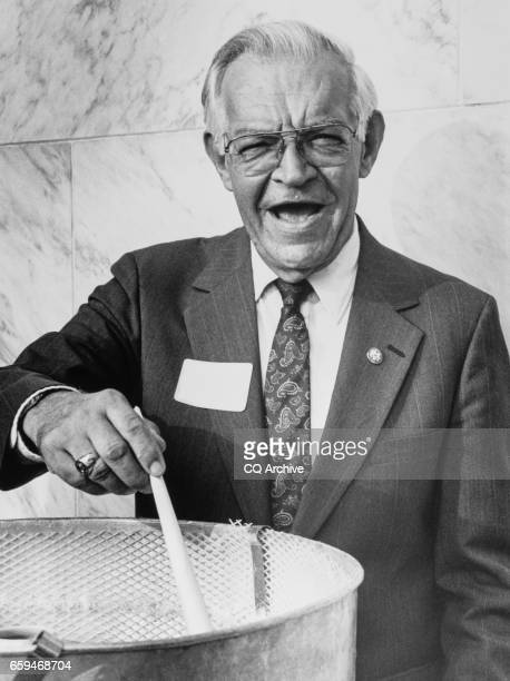 Rep Tom Lewis RFla at Florida state delegate party making cotton candy on July 11 1989 'r'n