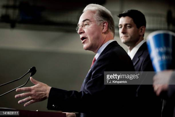 S Rep Tom Price speaks as House Budget Chairman US Rep Paul Ryan listens during the introduction of the House Budget Committee's FY2013 budget at a...