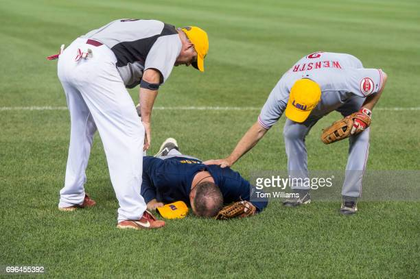 Rep Tom Rooney RFla is tended to after trying to field a pop up during the 56th Congressional Baseball Game at Nationals Park on June 15 2017