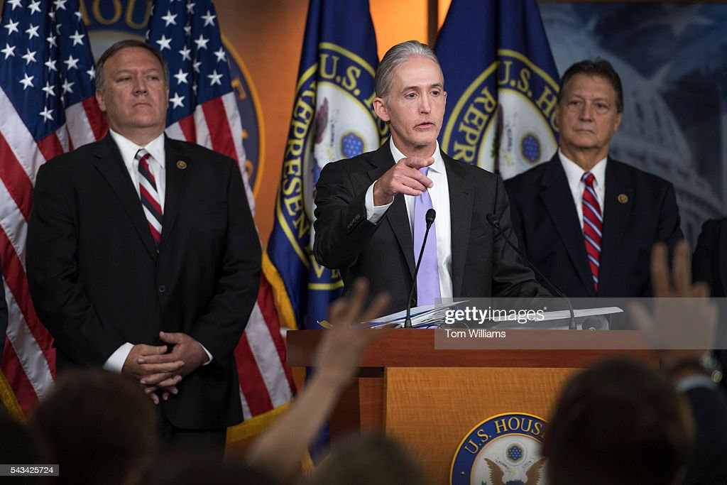Rep. Trey Gowdy, R-S.C., center, chairman of the Select Committee on Benghazi, conducts a news conference in the Capitol Visitor Center, June 28, 2016, to announce the Committee's report on the 2012 attacks in Libya that killed four Americans. Reps. Mike Pompeo, R-Kan., left, and Lynn Westmoreland, R-Ga., also appear.