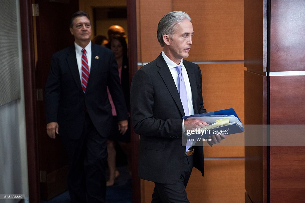 Rep. Trey Gowdy, R-S.C., right, chairman of the Select Committee on Benghazi, arrives for a news conference in the Capitol Visitor Center, June 28, 2016, to announce the Committee's report on the 2012 attacks in Libya hat killed four Americans. Rep. Mike Pompeo, R-Kan., also appears.