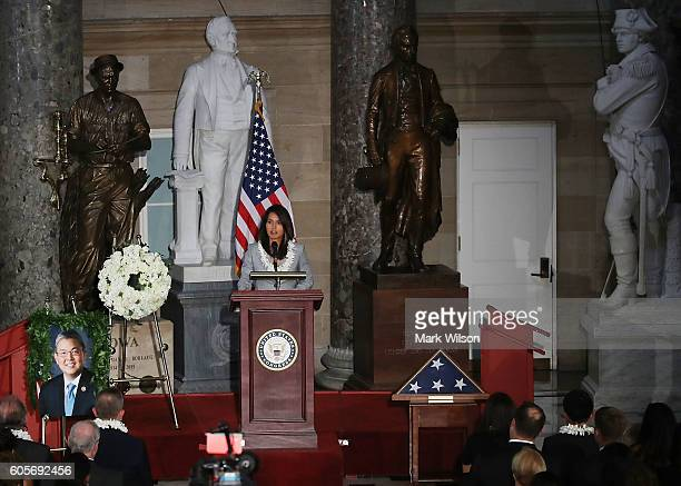 Rep Tulsi Gabbard speaks during a memorial service to honor the late Rep Mark Takai who died from pancreatic cancer last July at the US Capitol...