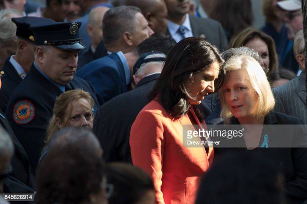 Rep Tulsi Gabbard talks with Sen Kirsten Gillibrand as they attend a commemoration ceremony for the victims of the September 11 terrorist attacks at...