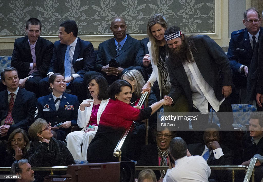 Rep. Vance McAllister's guest Willie Robertson of Duck Dynasty poses for photos in the gallery before President Barack Obama's arrival to deliver his State of the Union address to a joint session of Congress in Washington on Tuesday, Jan. 28, 2014.