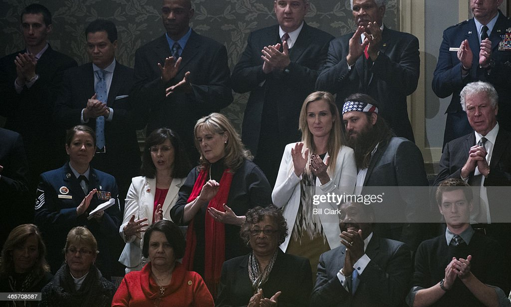 Rep. Vance McAllister's guest Willie Robertson of Duck Dynasty watches from the gallery during President Barack Obama's State of the Union address to a joint session of Congress in Washington on Tuesday, Jan. 28, 2014.