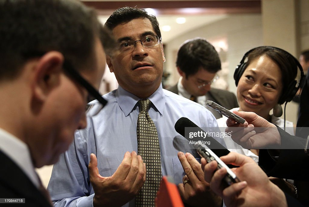 U.S. Rep. <a gi-track='captionPersonalityLinkClicked' href=/galleries/search?phrase=Xavier+Becerra&family=editorial&specificpeople=2369133 ng-click='$event.stopPropagation()'>Xavier Becerra</a> (D-CA) speaks to members of the media as he arrives at a closed briefing for members of the House of Representatives June 11, 2013 on Capitol Hill in Washington, DC. Officials from the National Security Agency, Federal Bureau of Investigation and Department of Justice were on the Hill to brief House members on the National Security Agency and government surveillance programs.
