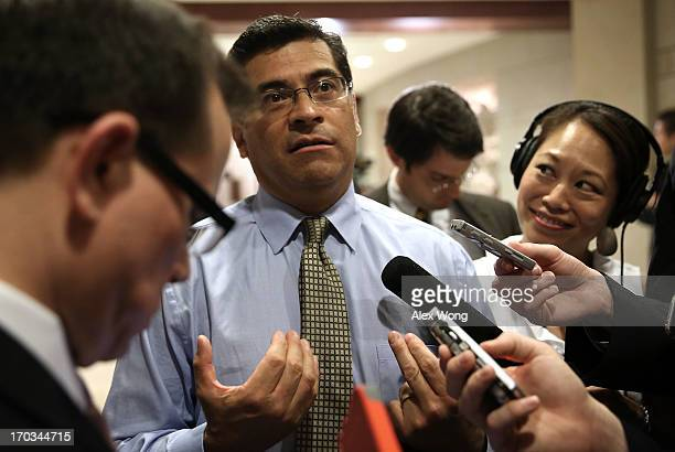 S Rep Xavier Becerra speaks to members of the media as he arrives at a closed briefing for members of the House of Representatives June 11 2013 on...