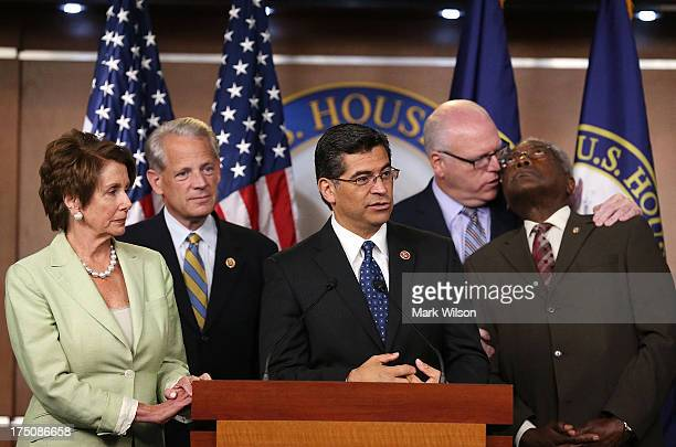 Rep Xavier Becerra speaks to the media while flanked by House Minority Leader Nancy Pelosi Rep Steve Israel Rep Joseph Crowley and Rep James Clyburn...