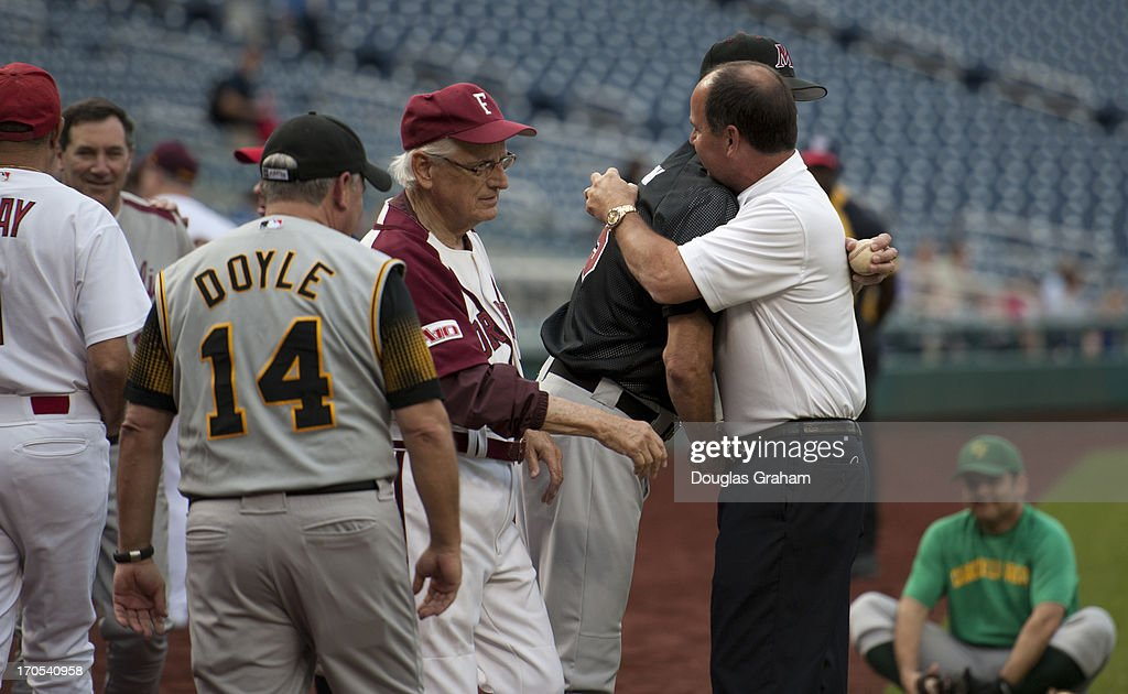 Rep. Zack Wamp gets a hug from members of the Democratic team after he received his induction into the Roll Call Congressional Hall of Fame at the 52nd annual Congressional Baseball Game at National Stadium in Washington on Thursday, June 13, 2013.