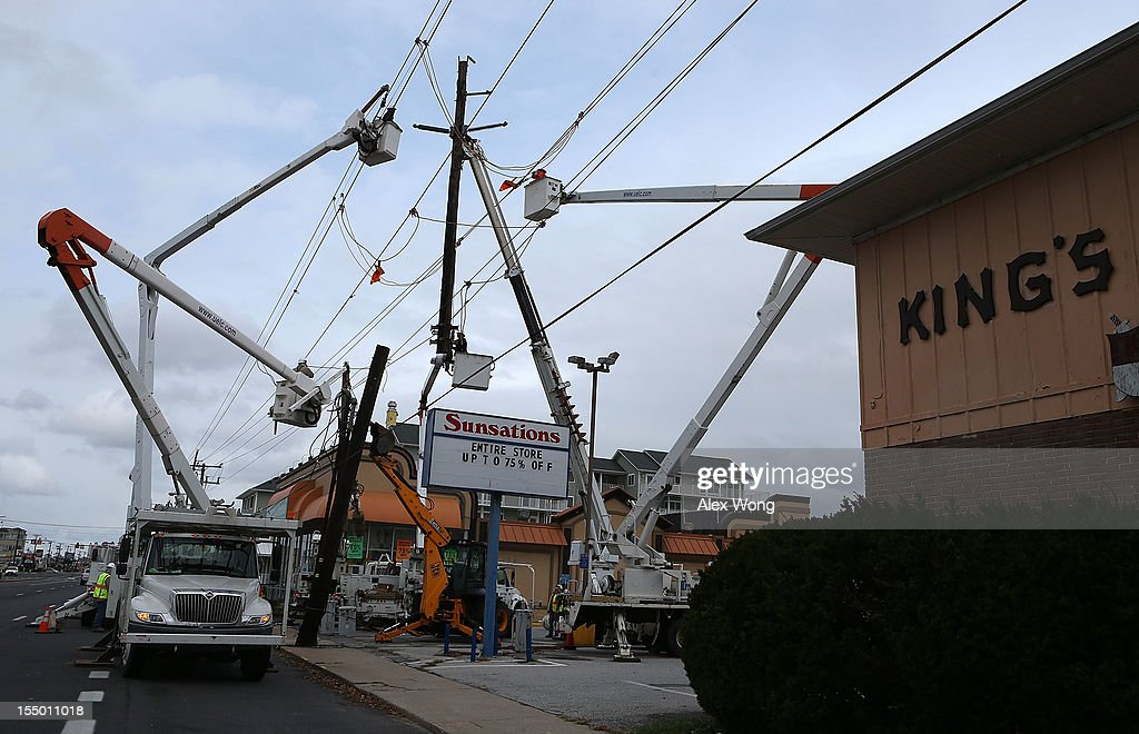 Repair crew members of Delmarva Power replace a power pole which was damage during Hurricane Sandy October 30, 2012 in Ocean City, Maryland. The storm has claimed at least 33 lives in the United States, and has caused massive flooding across much of the Atlantic seaboard. U.S. President Barack Obama has declared the situation a 'major disaster' for large areas of the U.S. east coast, including New York City, with widespread power outages and significant flooding in parts of the city.