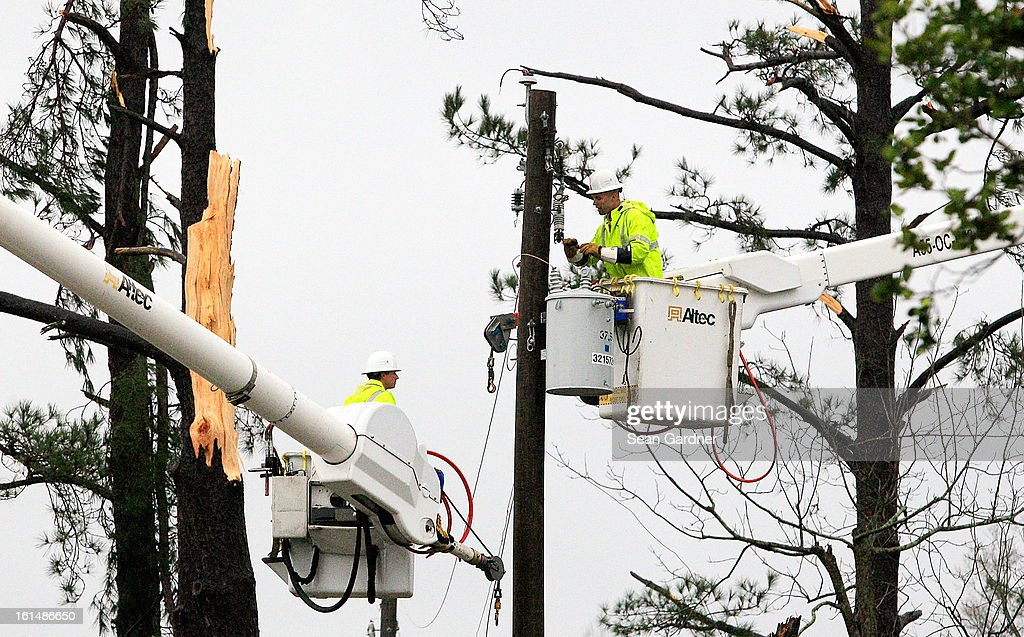 Repair crews attempt to fix power lines after a tornado touched down yesterday evening February 11, 2013 in Hattiesburg, Mississippi. Hundreds of homes were destroyed and over sixty people injured when the tornado ripped through the town.
