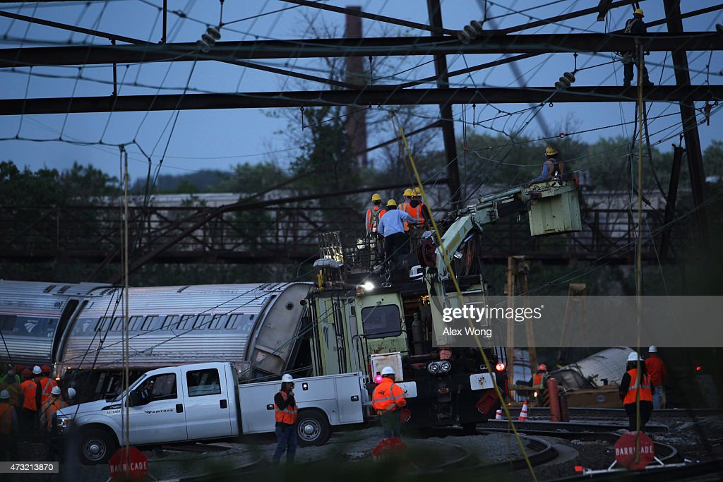 Repair crews inspect damages at the site of a train derailment accident May 13 2015 in Philadelphia Pennsylvania Service has been interrupted after...