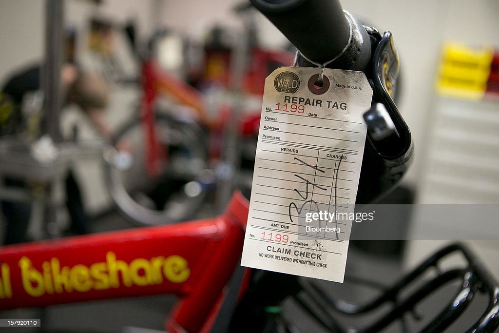 A repair tag hangs off a Capital Bikeshare bicycle at the headquarters in Washington, D.C., U.S., on Friday, Nov. 30, 2012. Since Sept. 2010, Capital Bikeshare has dispersed more than 1700 bikes for rent across the city and has totaled over 3.5 million rides since Sept. 2011. Alta Bicycle Share, the company that was awarded the contract to run the program, has installed 191 solar-powered docking stations throughout the District and Arlington, Virginia. Photographer: Andrew Harrer/Bloomberg via Getty Images
