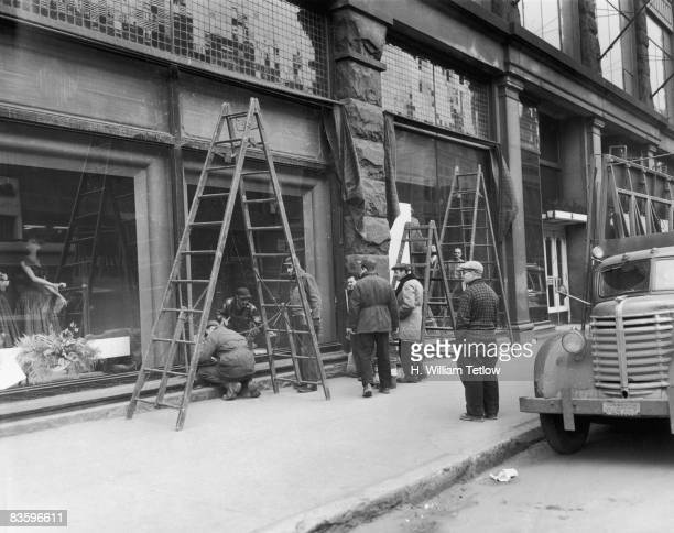 Repair work is carried out on the Montreal Forum Montreal Canada after rhe previous night's riot over the suspension of Montreal Canadiens ice hockey...