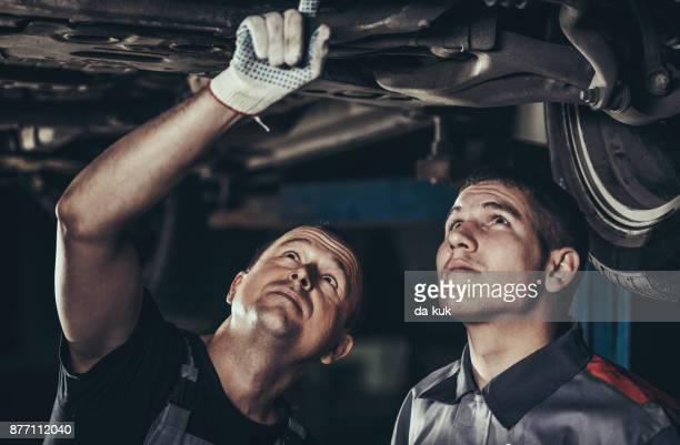 Repairing a car in auto repair shop