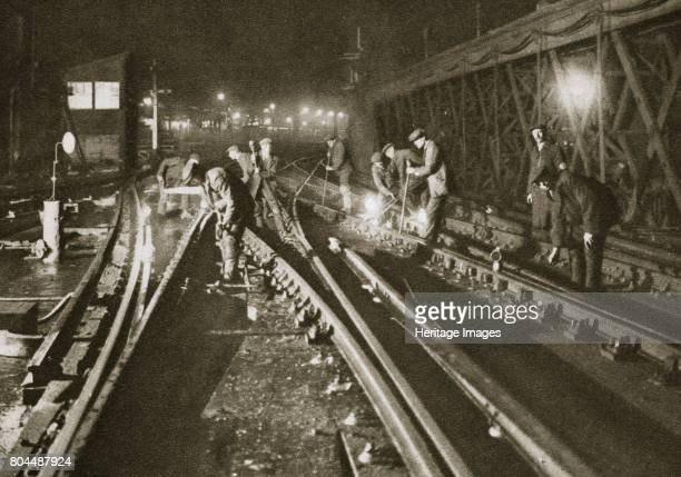 Repairing a railway track Charing Cross Bridge London 20th century The bridge is officially known as Hungerford Bridge It carries trains over the...