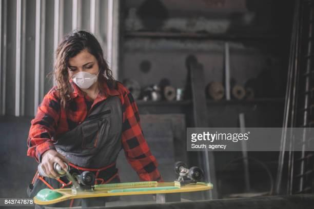 Repairing skateboard in garage