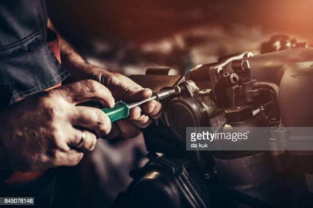Repairing V10 engine in auto repair shop
