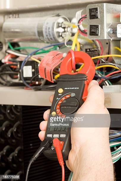 Repairman Checks Amperage on Geothermal HVAC System