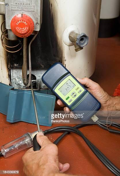 Repairman Checks Carbon Monoxide Level on Gas Water Heater Burner