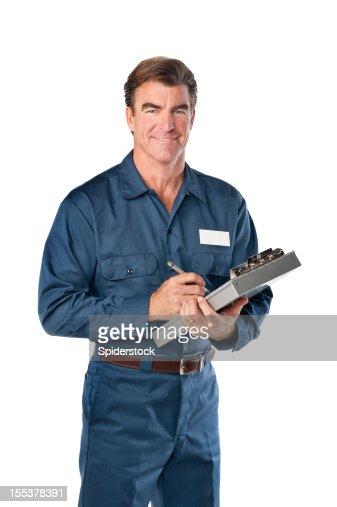 Repairman in blue uniform with clipboard