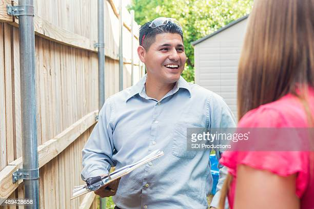 Repairman or insurance agent examining homeowner's property