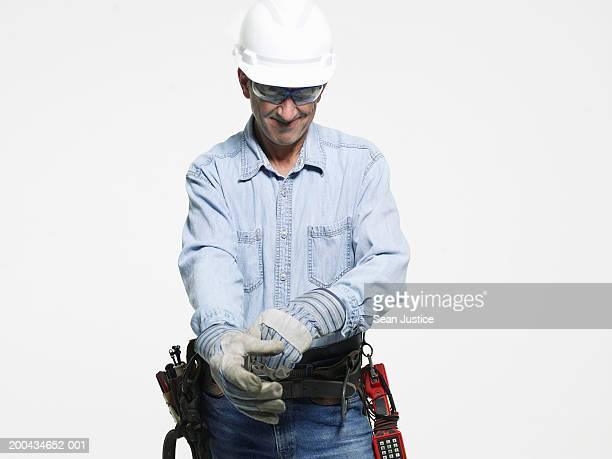 Repairman putting on glove, close-up