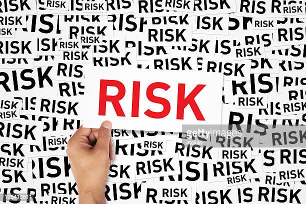 Repeating background of the word risk with large sign in red