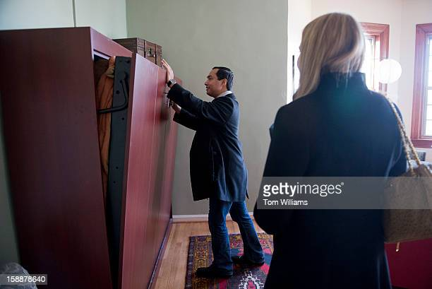 Repelect Joaquin Castro DTexas checks out a murphy bed while apartment hunting on Capitol Hill