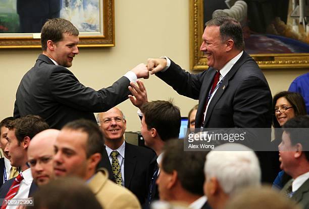 S Repelect Mike Pompeo shares a fist bump with his aide Keith Dater after he drew number two making him the second one to pick office during an...