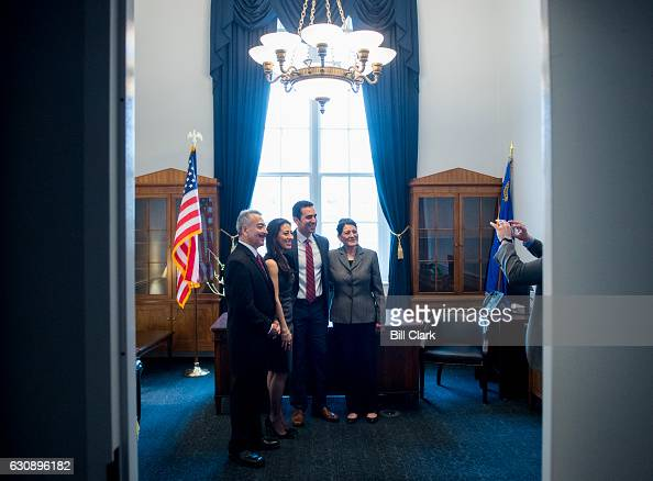 Repelect Ruben Kihuen DNev poses for a photo with his parents and sister in his new Congressional office in the Cannon House Office Building before...