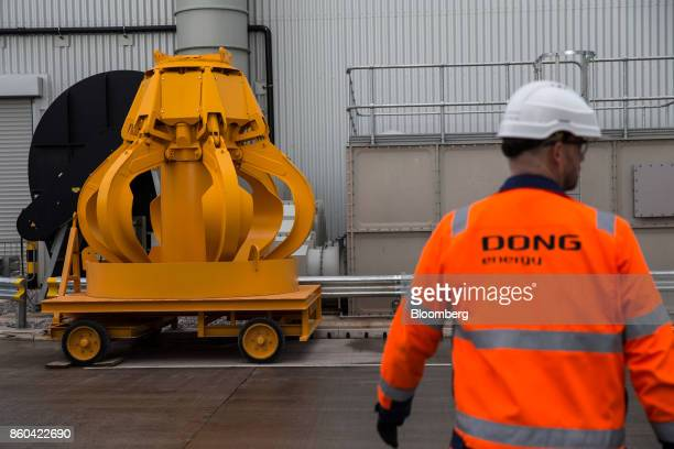 A replacement claw for the bunker hall machinery sits at the Renescience waste energy plant operated by Dong Energy A/S in Northwich UK on Thursday...