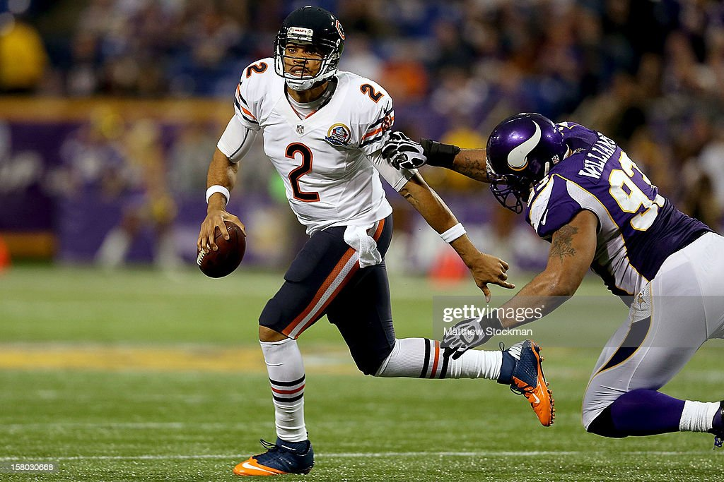Replacement Quarterback Jason Campbell #2 of the Chicago Bears is chased out of the pocket by Kevin Williams #93 of the Minnesota Vikings at Mall of America Field on December 9, 2012 in Minneapolis, Minnesota.