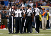 Replacement referees huddle during a timeout in the game between the Washington Redskins and the St Louis Rams at Edward Jones Dome on September 16...